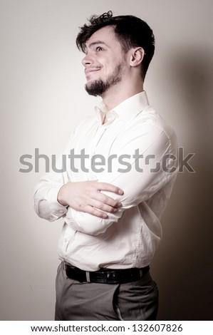 stylish modern guy with white shirt on gray background