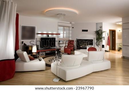 Stylish modern living room with cream settee.