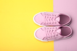 Stylish new shoes on color background, top view