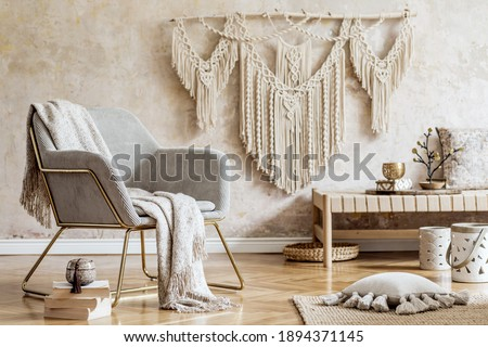 Stylish oriental living room with design armchair, beautiful macrame, carpet, decorations and elegant personal accessories in wabi sabi concept. Foto stock ©