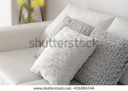 Stylish pillows on grey couch #426886546