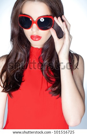 Stylish portrait of a beauty wearing dark shades