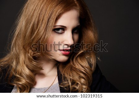 Stylish portrait of young beautiful girl.