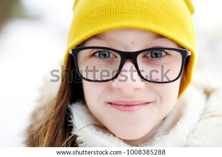 759c2924 Stylish pre teen girl 10-12 year old wearing yellow knitted hat and bblack  jacket