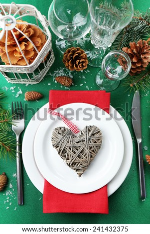 Stylish red, green and white Christmas table setting