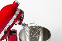 Stylish Red Kitchen Mixer With Clipping Path Isolated On White Background. Professional steel electric mixer with Metal Whisk