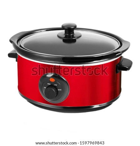 Stylish Red Slow Cooker in Stainless Steel Isolated on White Background. Modern Cooker with Keep Warm Function & Removable Pot Front View. Small Domestic and Kitchen Appliances. Power Indicator Light Stock photo ©
