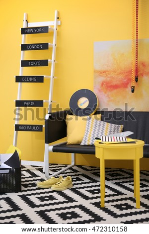 Stylish room interior on yellow wall background #472310158