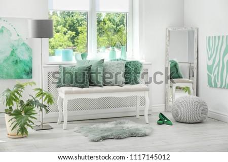 Stylish room interior with mint decor elements