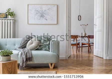 Stylish scandinavian living room and dining room with design mint sofa, mock up poster map, plants and elegant personal accessories. Modern home decor. Open space. Template. Ready to use.