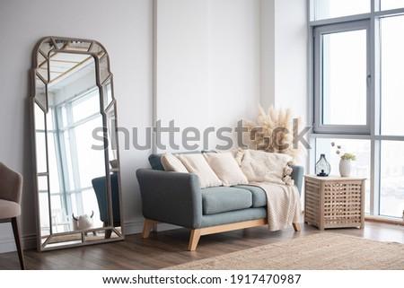 Stylish Scandinavian modern white cozy eco interior in minimalist style.Modern home decor. Open space.