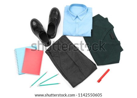 Stylish school uniform and stationery on white background, top view