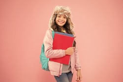 Stylish schoolgirl. Girl little fashionable schoolgirl carry backpack. Schoolgirl daily life. Modern education. Final exams. Arrival day. Academic term. Winter semester. Teen with backpack and books.