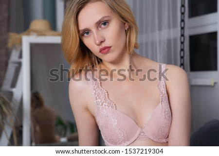 Stylish sensual young woman with in lingerie is looking at you. Portrait of a sexy girl.