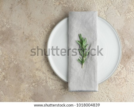 Stylish serving on a gray ceramic plate handmade gray linen napkin and sprig of rosemary