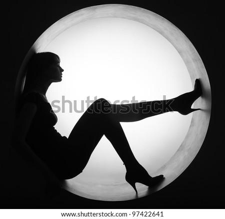 stylish silhouette beautiful woman in circle