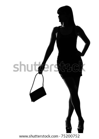 stylish silhouette caucasian beautiful woman holding purse waiting full length on studio isolated white background