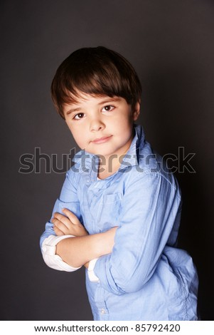 Stylish smiling beautiful little boy. Studio shot - stock photo