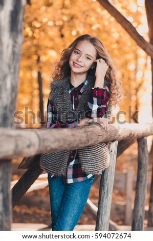 Stylish Smiling Teen Girl 12 14 Year Old Posing Outdoors Wearing Casual Clothes