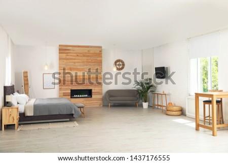 Stylish studio apartment interior with comfortable furniture #1437176555