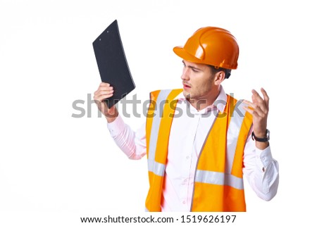 stylish stylish foreman man with a folder in his hand