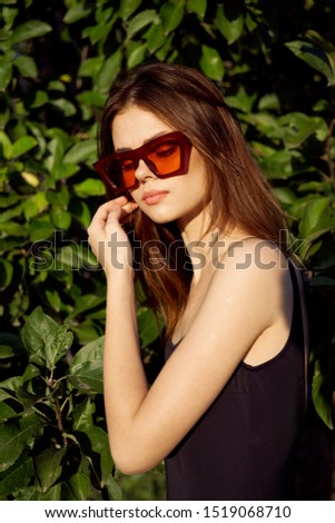 stylish stylish woman with glasses in the sun tans