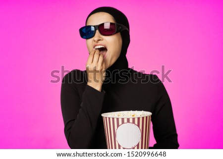 stylish stylish woman with glasses with popcorn