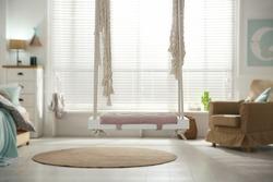 Stylish swing in child's room. Interior design