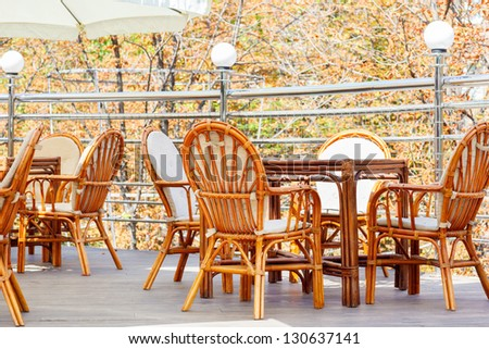 Stylish tables and chairs in an open air cafe terrace