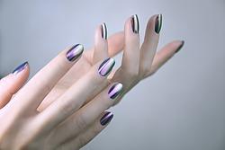 Stylish trendy female mirror manicure. Metal Nail Art. Chrome Nails.