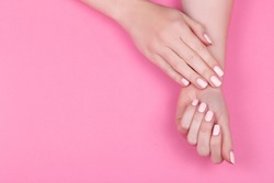 Stylish trendy female pink manicure.