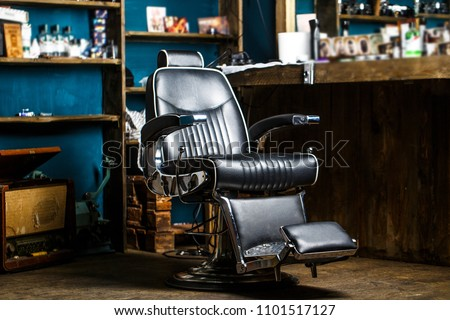 Stylish vintage barber chair. Barbershop theme. Professional hairstylist in barbershop interior. Barber shop chair. Barbershop armchair, modern hairdresser and hair salon, barber shop for men.