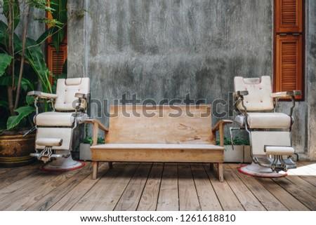 Stylish Vintage Barber Chair in Loft Interior. Barbershop Decoration #1261618810