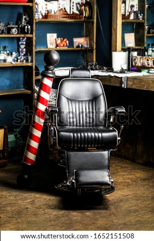 Stylish vintage barber chair. Logo of the barbershop, symbol. Barber shop pole. Hairstylist in barbershop interior. Barber shop chair. Barbershop armchair, salon, barbershop for men.