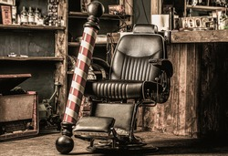 Stylish vintage barber chair. Professional hairstylist in barbershop interior. Barber shop chair. Barbershop armchair, modern hairdresser and hair salon, barber shop for men.
