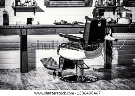 Stylish vintage barber chair. Professional hairstylist in barbershop interior. Barbershop armchair, modern hairdresser and hair salon, barber shop for men. Barber shop chair. Black and white.