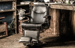 Stylish vintage barber chair. Professional hairstylist in barbershop interior. Barbershop interior. Barber shop chair. Barbershop armchair, modern hairdresser and hair salon, barber shop for men.