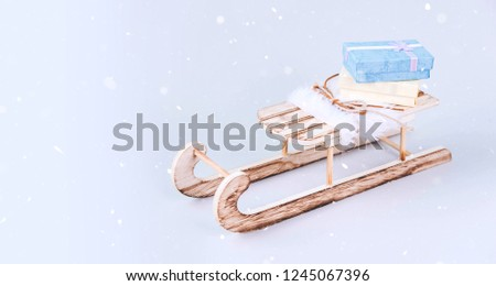 Stylish vintage wooden sled on bright background.