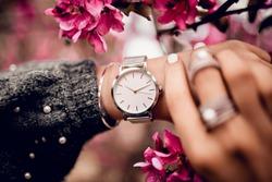 Stylish watch on woman hand