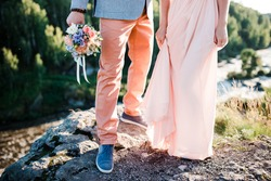 Stylish wedding couple on the river bank