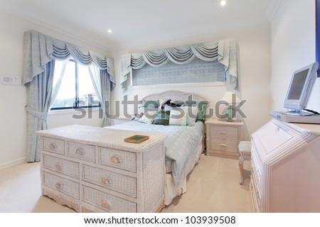Stylish white bedroom in luxury house