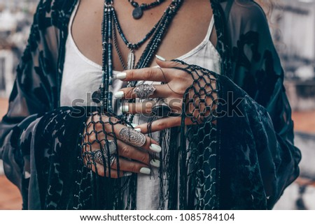 stylish woman hands close up with boho accessories #1085784104