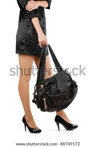 Stylish woman holding black leather bag