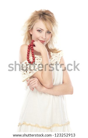 Stylish woman holds red beads on a white background