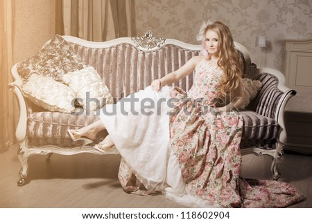 Stylish woman in a vintage dress in a luxurious interior