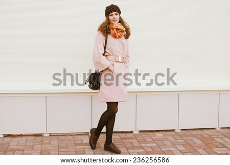 Stylish woman in coat with bag outdoors in the city #236256586