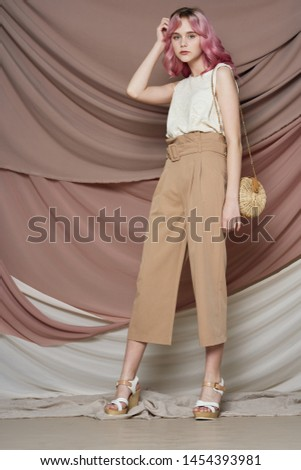 stylish woman in stylish clothes with a handbag