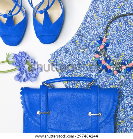 Stylish woman outfit in blue colors on white background
