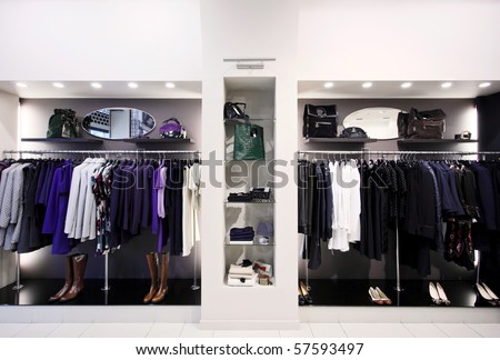 Stylish women's clothes on hangers in shop