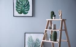 Stylish wooden ladder in modern room interior